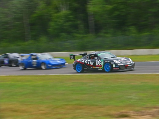 Porsche Cayman passing a 914. Notice how the 914 (Blue) is clearly moving slower than the Cayman (Black/blue wheels).