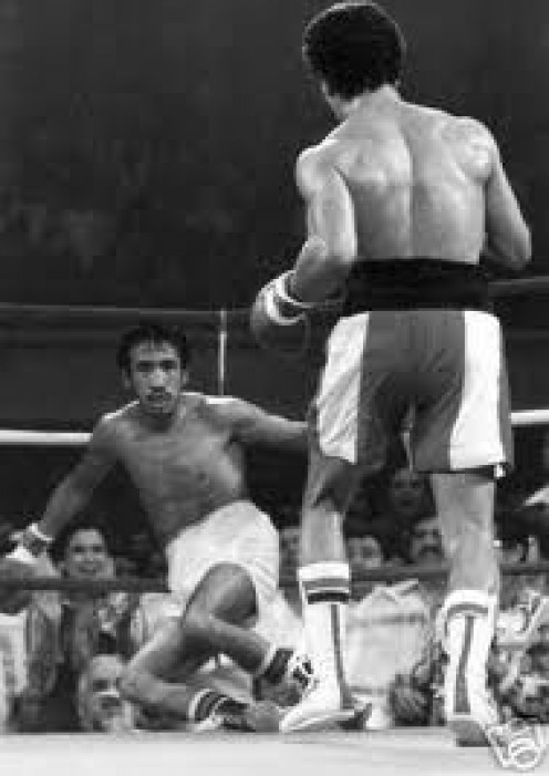 Wilfredo Gomez puts Carlos Zarate on the deck during their confrontation. Gomez is one of the hardest punching bantamweight boxers of all time.