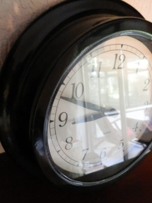 This clock pic now has depth and character, hinting at what lies beyond it through the reflected images