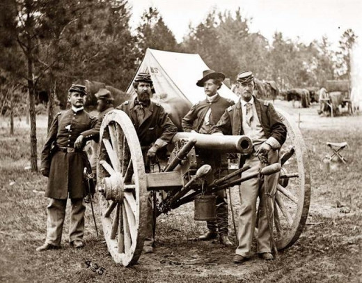 Eager Militia officers clustered about a cannon