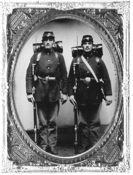 Two Union Volunteers pose for an ambrotype photograph circa 1861