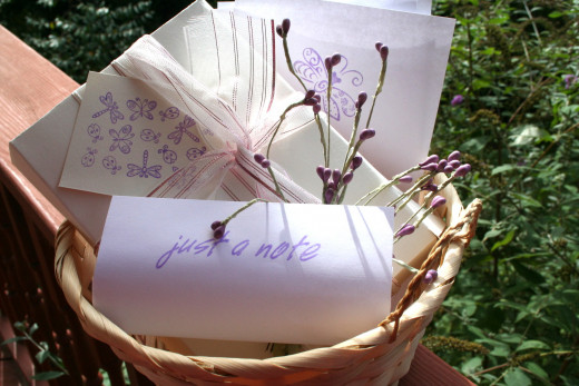 Handmade stationery in basket.