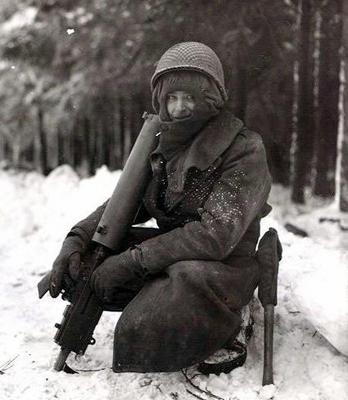 Soldier with water-cooled .30 caliber machine gun during the Bulge.