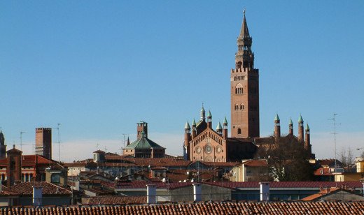 A view of Cremona, with the bell tower Torrazzo, the upper part of a side facade of the Cathedral and the baptistere on the left.