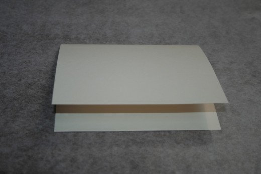 Make a greeting card from a cardstock base.  Cut 8 1/2 x 11 cardstock in half and fold.