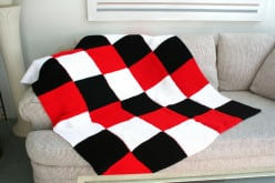 Warm and cozy checkered knitted afghan