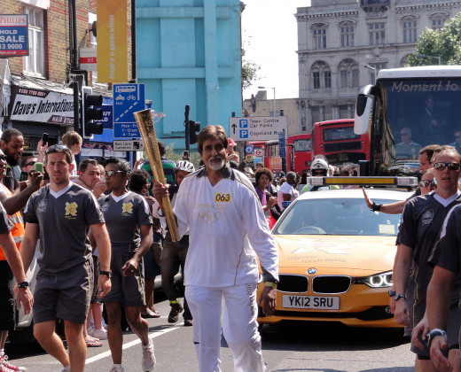 Amitabh Bachchan  taking part in  the olympic  relay torch.