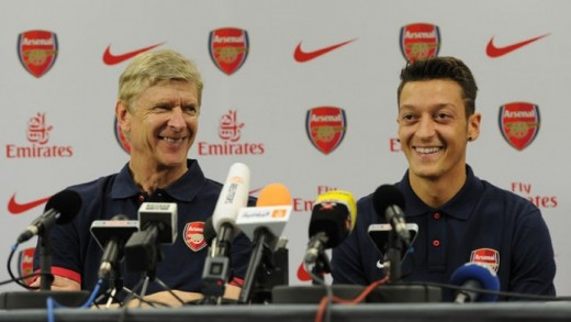 Arsenal manager, Arsene Wenger with new German signing Mesut Ozil at a press conference.
