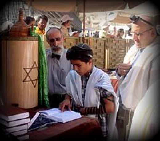 220px-Jewish_boy_reads_Bar_Mitzvah.jpg