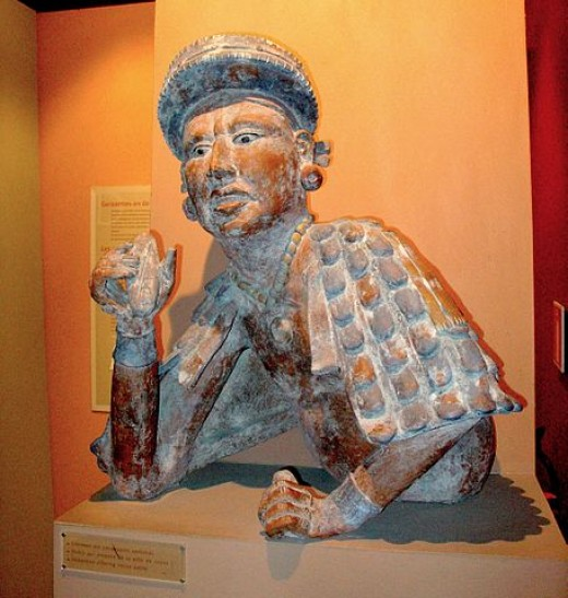 Sculpture of a Mayan nobleman holding cocoa paste