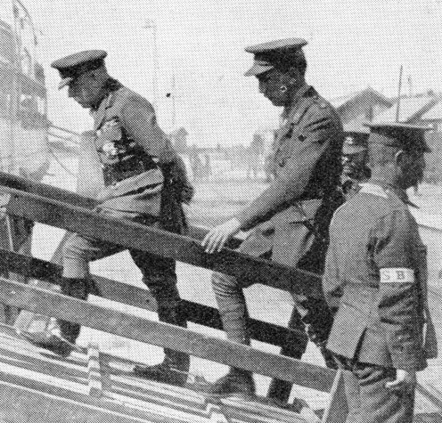 General Sir John French walking the gangway on to a British hospital ship to inspect the wounded.
