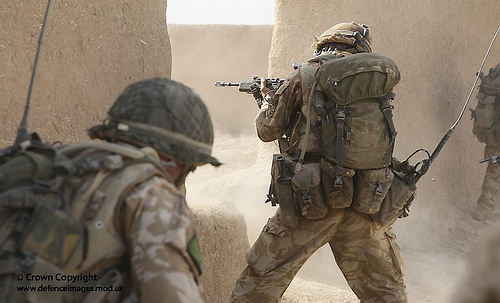 Paratrooper returns fire in Afghanistan from UK Ministry of Defense  flickr.com