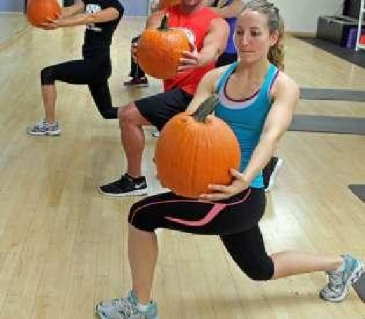 Do lunges with pumpkins.