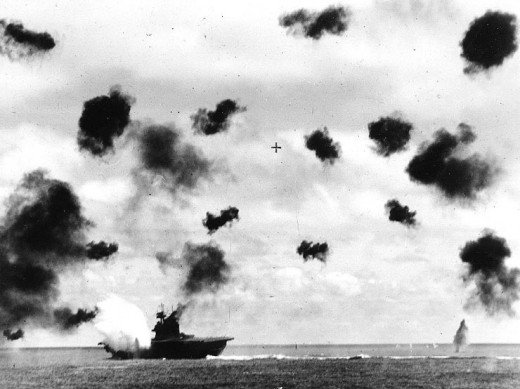 USS Yorktown (CV-5) is hit on the port side, amidships, by a Japanese Type 91 aerial torpedo during the mid-afternoon attack by planes from the carrier Hiryu, in the Battle of Midway, on 4 June, 1942.