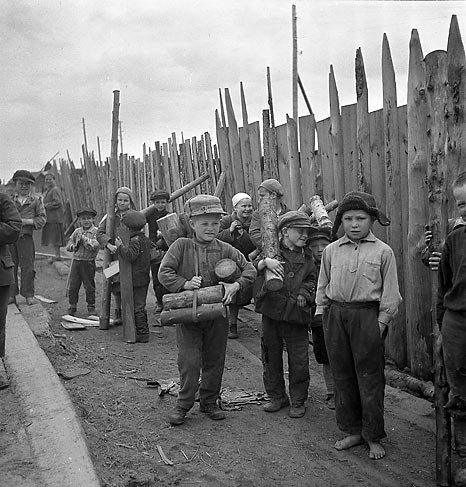 Russian children from eastern Karelia in a Finnish internment camp gathering wood. The Russians were regarded as unreliable and were held interned during the war.