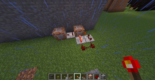 Two command blocks joined by a comparator, powered by a small, simple redstone clock.