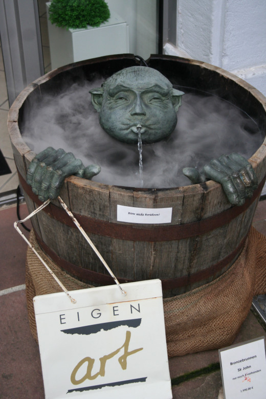 Clever fountain outside shop in Heidelberg, Germany