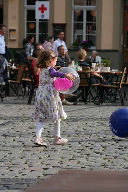 Little girl in Marktplatz - Heidelberg, Germany