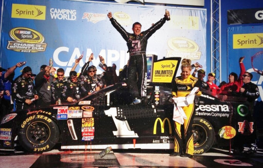 Jamie McMurray celebrates his win at Talladega, beating all 13 Chase drivers in the process