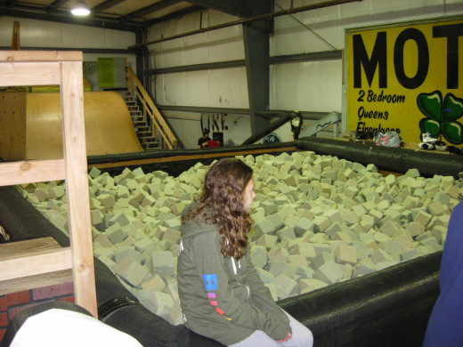 The foam pit. The ramp behind it is used by skateboarders, rollerbladers, and BMXers to fly into.
