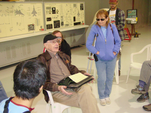 Dick Dinning addresses a small group with tales of piloting a B 17 over Germany in WW2