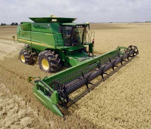 Farmers are starting to share heavy machinery like this in order to cut costs.