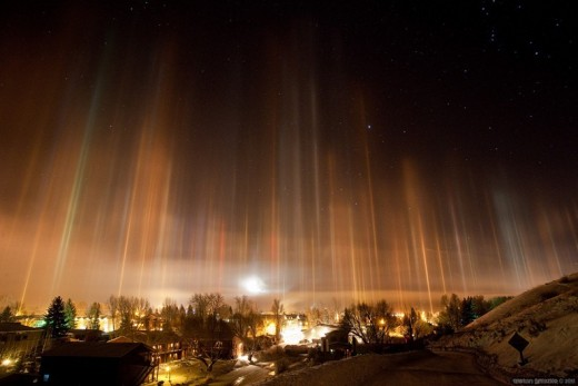 Light pillars form when light (from the sun, moon,or man-made lights) is reflected in ice crystals found in the Earth's atmosphere.