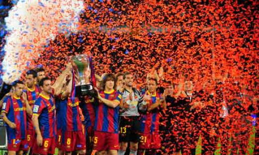 The Barcelona team celebrate their Champions League win.