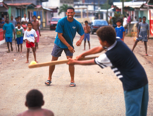 Stickball with Mariano Rivera, having fun in the community.
