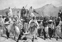 A 19th-century engraving depicting an Arab slave-trading caravan transporting black African slaves across the Sahara.
