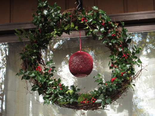 My Holiday Bird Feeder Wreath is made with real holly from my shrubs.