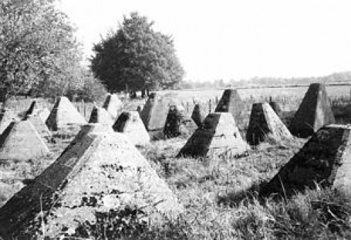 These square-pyramidal barriers were used extensively by all sides in World War II in an effort to impede the movement of enemy forces.  What were they called?