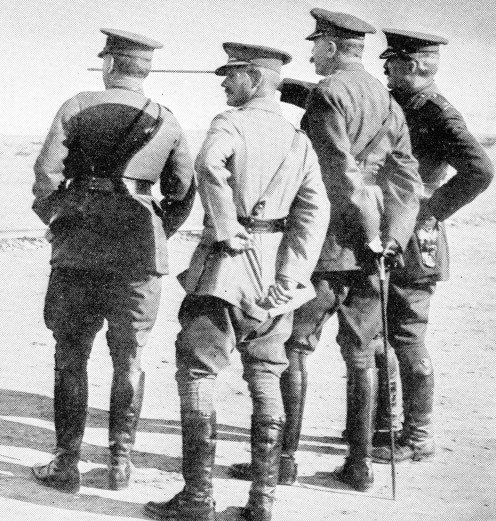 Major-Gen. Davies pointing out Gallipoli positions, in the direction of Achi Baba, to Lord Kitchener. Standing on the left of Lord Kitchener are General Birdwood, of Anzac fame, and General Maxwell, K.C.B., the General Officer Commanding in Egypt.