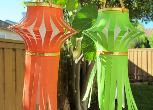 If you are on a tight budget, you can make DIY lanterns. They're quite easy to find ideas for and make. All you need is paper, glue, and other materials.