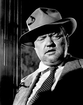 A stout Orson Welles by 1958.  Gone are his svelte and handsome Citizen Kane days.  Welles would use his enormous size to an advantage by writing his weight gain into the script.  The cause of his massive size: Unrequited love for the femme fatale.
