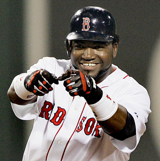 Big Papi celebrates as he leads Boston to his third title in a Red Sox uniform.