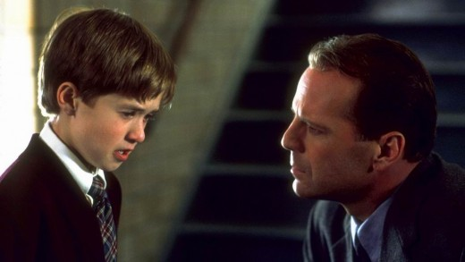 Haley Joel Osment with Bruce Willis in The Sixth Sense (1999)