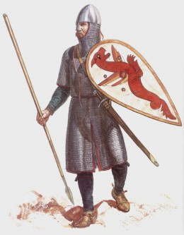 A huscarl in a knee-length mailcoat carries his new kite-shaped shield in his left, a spear in his right hand. Earl Harold introduced these shields to his huscarls around the time of his feted sojourn as Duke William's 'guest'.