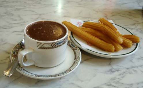 Churros y chocolate a famous snack and/or breakfast in Spain and Mexico today.