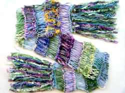 The natural shades in this scarf are a perfect colour combination for making jewellery with purple beads.