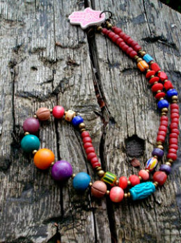 Purple beads used in a rainbow palette with other coloured beads stands out.
