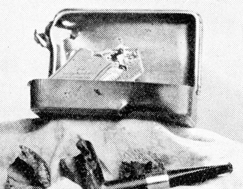 Princess Mary's gift-box, which saved the life of Private Metcalfe, Royal West Kents, by deviating the course of a bullet which, however, shattered the pipe, passed through the box, and killed a man standing near him in the trenches.