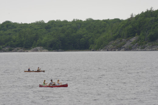 Two canoes in the middle of a channel of the Georgian Bay.