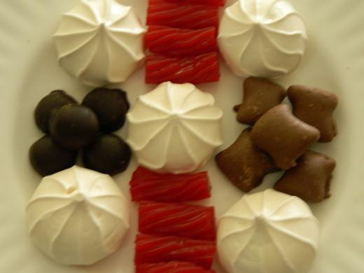 Left :meringue cookies, dark chocolate mints. Center: strawberry licorice, meringue cookie Right: meringue cookies,chocolate peanut butter covered pretzels