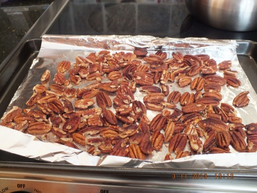 Pecans have been toasted under the broiler for about 3 minutes. You can tell they are ready by the delicious aroma they release.