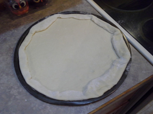 Step Five: Lay out the dough on the pan and fold in the edges