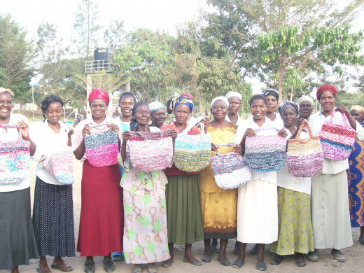 The widows carrying purses I blessed them with, made by a neighbor of mine, for allowing me to interview them and get their stories.  The book will be published hopefully next year if God willing.