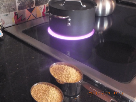 Heating up the water to cook the millet.