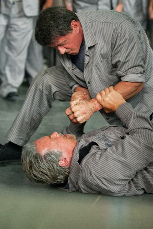 Fists fly hard and fast in the thriller Escape Plan featuring Sylvester Stallone and Arnold Schwarzenegger