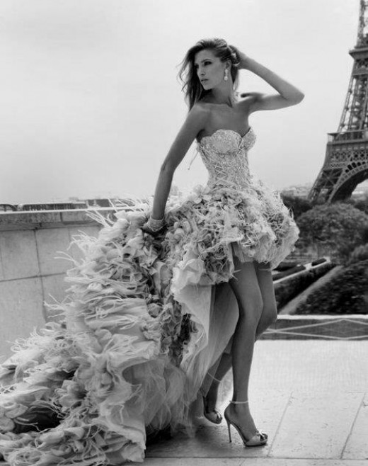 Beautiful woman in forefront of Eiffel Tower